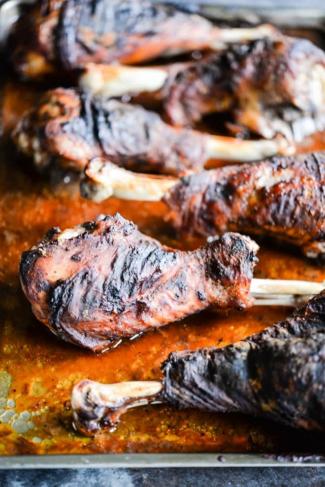 These BBQ turkey legs are roasted in the oven to juicy perfection and come together quickly with just a few ingredients for the perfect change-up to your normal Thanksgiving protein! | Fed & Fit