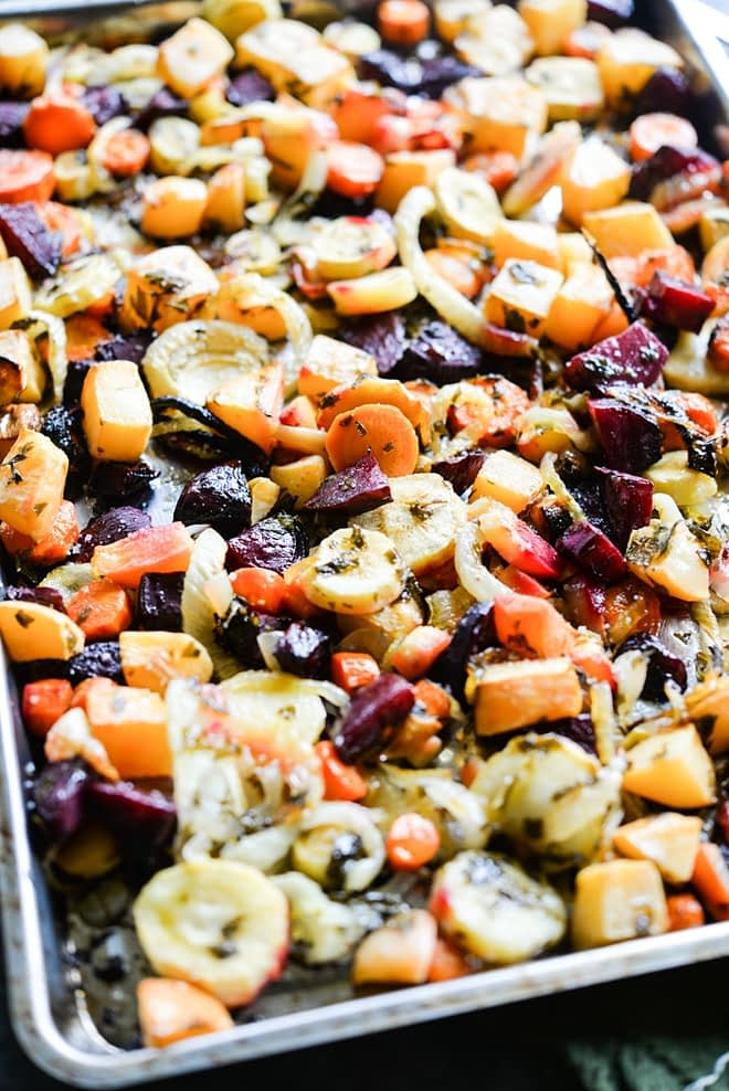 This winter root veggie roast combines carrots, parsnips, beets, fennel, and more until crisp with a flavorful lemon-parsley vinaigrette. It is the perfect way to enjoy the season's bounty of root vegetables!