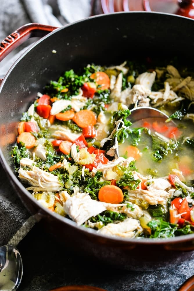 leftover shredded chicken soup with veggies in a pot