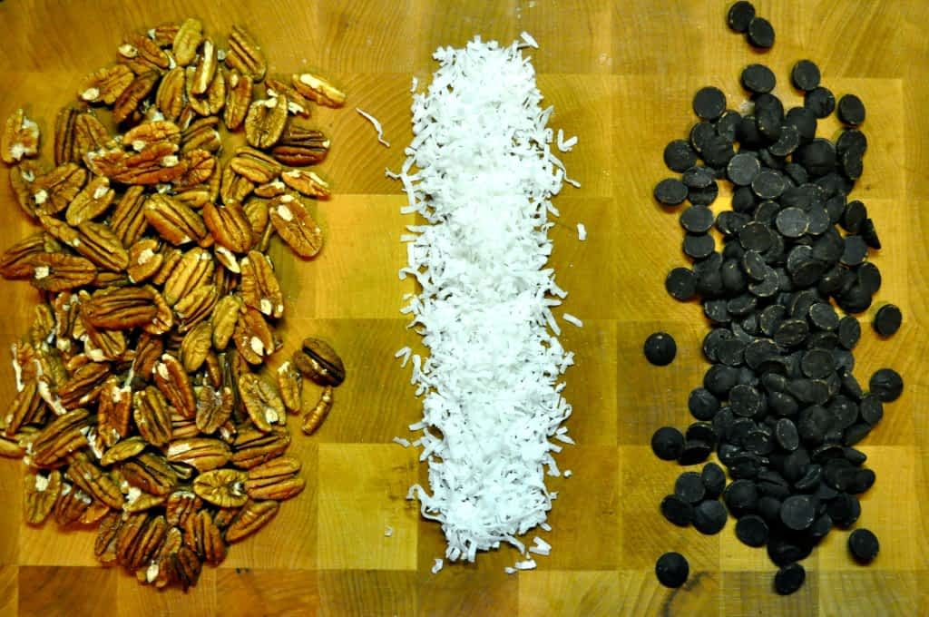 overhead view of ingredients for dark chocolate chili pecan clusters