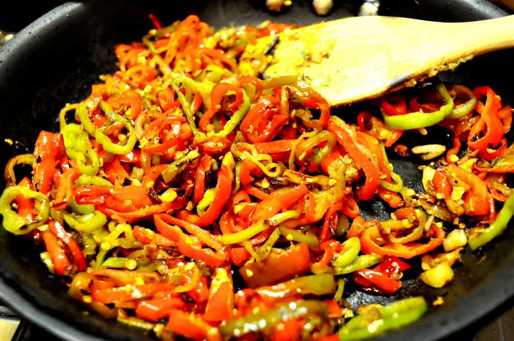 onions and peppers in a pan