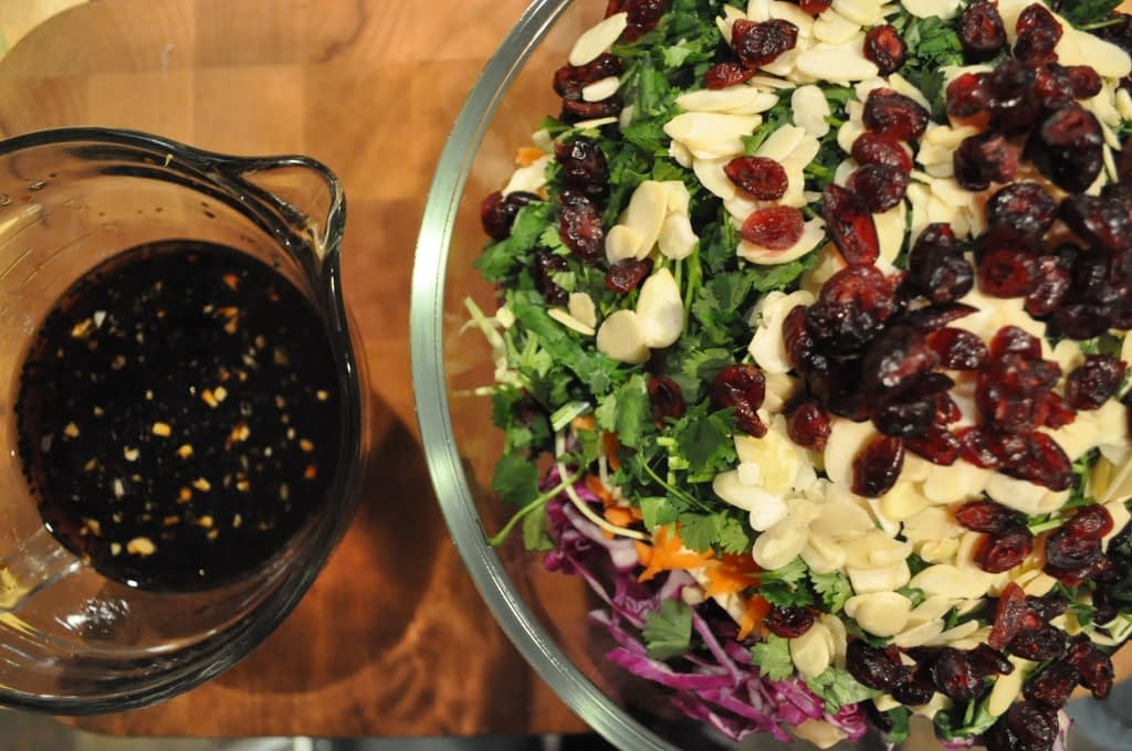 overhead view of two bowls with ingredients for dressing and asian coleslaw