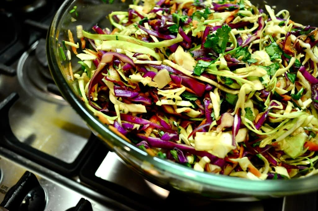 glass bowl of asian coleslaw on a stove