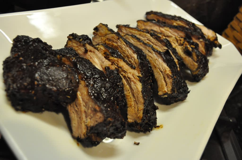 a white platter of Chinese short braised ribs