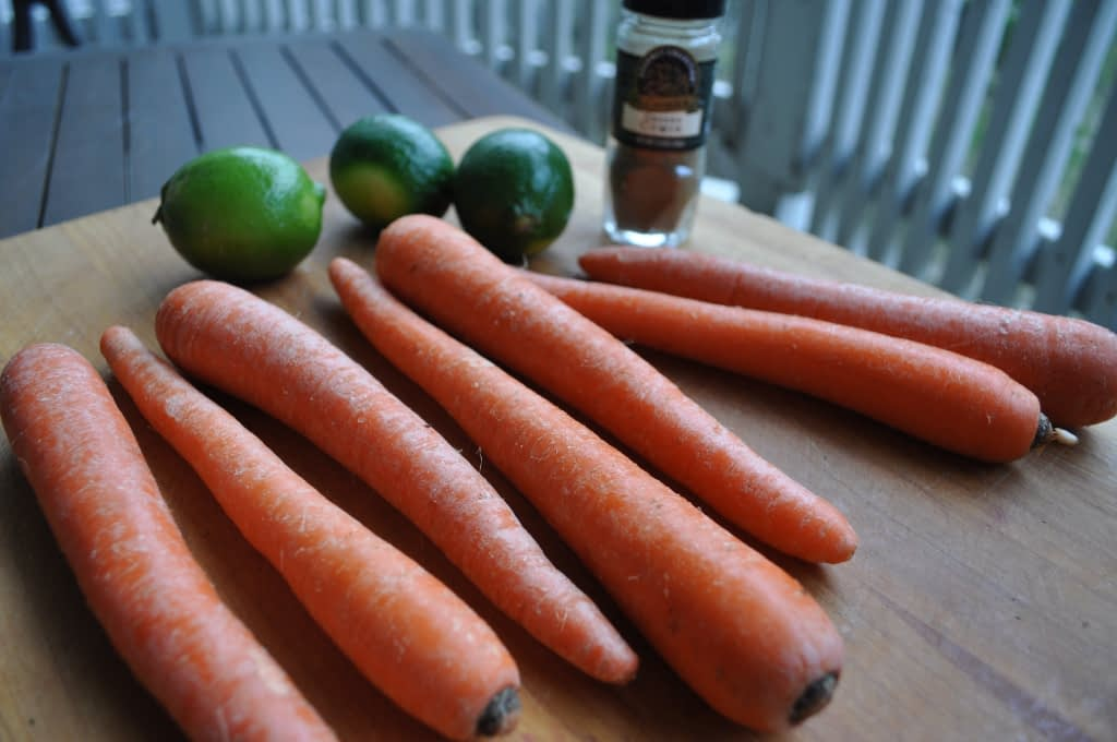 carrots and limes on a cutting board