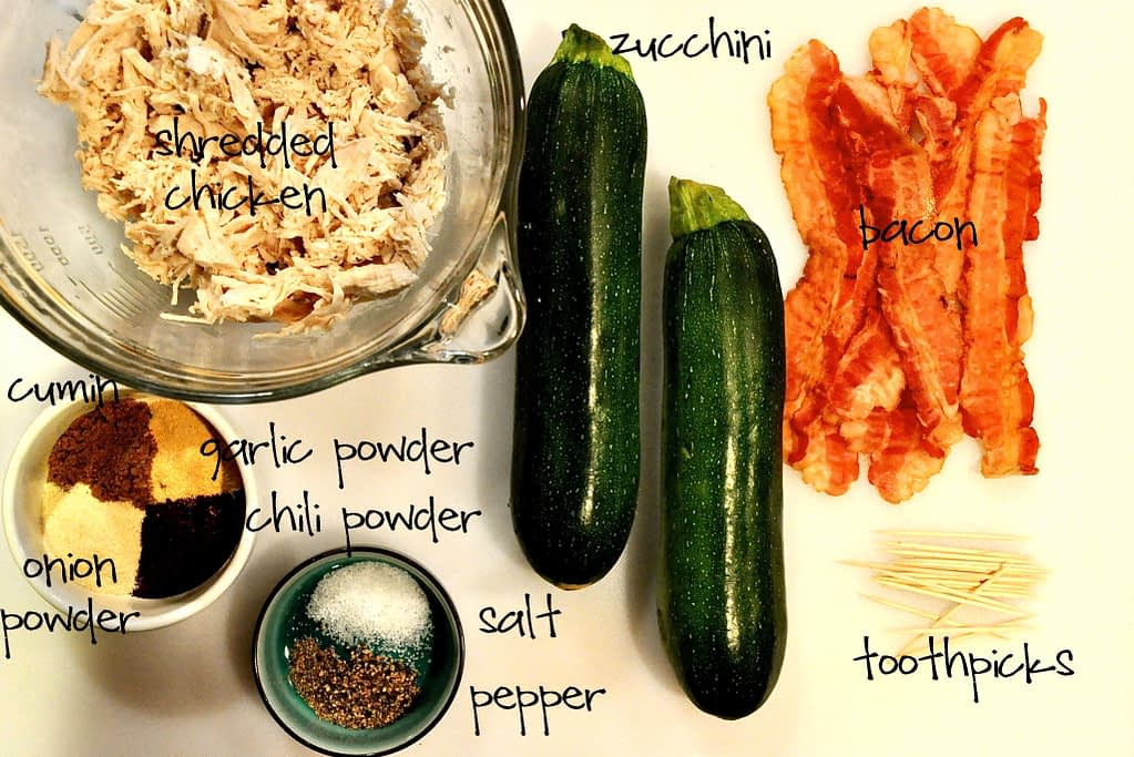overhead view of ingredients to make a bacon wrapped stuffed zucchini