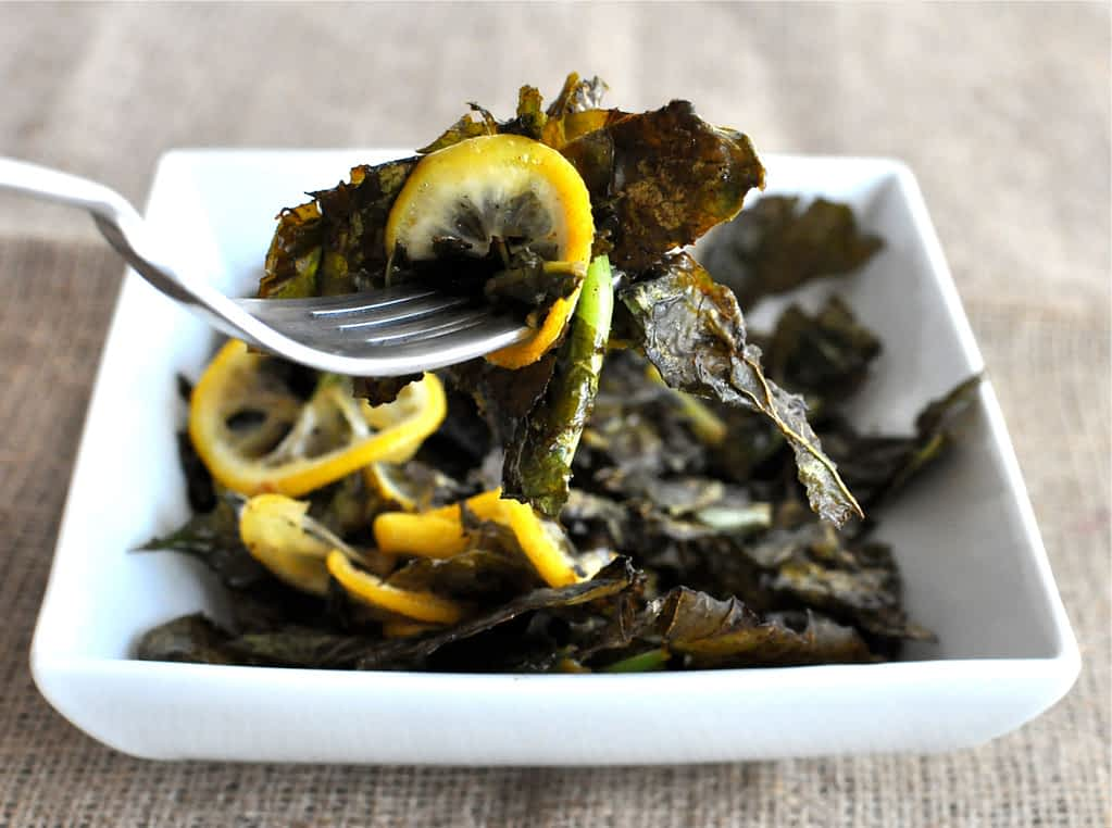 a forkful of charred turnip greens and lemon slices