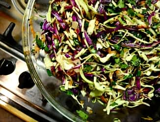 overhead view of bowl of prepared asian coleslaw on the stove
