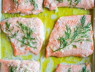 dill and garlic baked salmon on parchment paper