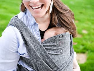 woman wearing a baby in a carrier