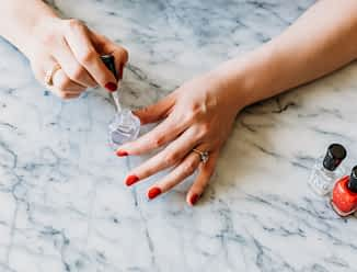 woman painting her nails with non-toxic nail polish