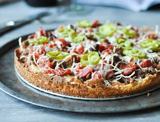 a whole Chicago deep dish pizza on a round sheet pan