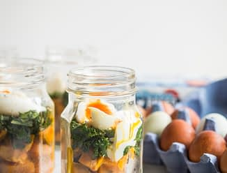 make-ahead balanced breakfast jars - sweet potatoes, kale, and soft boiled eggs in a mason jar on a marble board