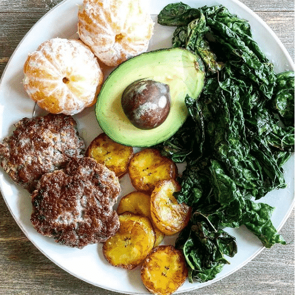 DIY Egg Free Breakfast plate with sausage, oranges, avocado, kale and plantains