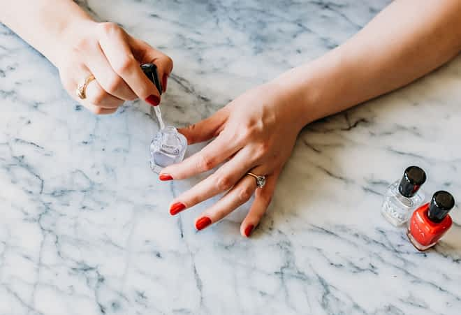 woman using non-toxic nail polish to paint her nails