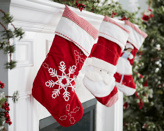 3 stockings hung on a white fireplace