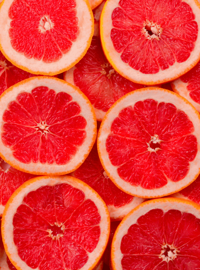 red grapefruit slices laid on top of one another - grapefruit is one way to prepare your body for pregnancy