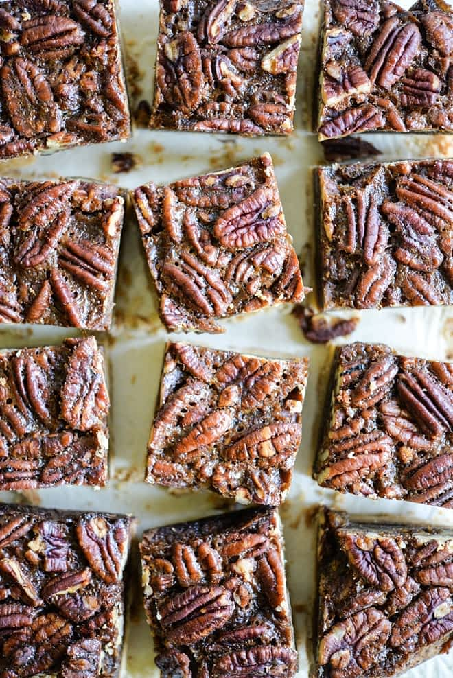 These pecan pie bars are gluten and refined sugar-free and combine traditional pecan pie filling with a buttery shortbread crust. They are perfect to impress your guests this Thanksgiving! | Fed & Fit