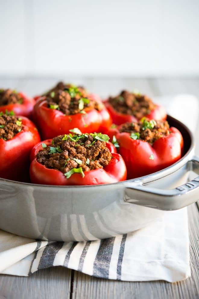 Curried Beef & Butternut Squash Stuffed Peppers in a skillet