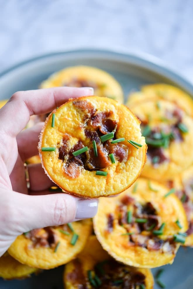 These butternut squash egg muffins are the perfect freezable, make-ahead breakfast for the week! The perfect combo of sweetness from the squash and salt from the bacon, these portable breakfast are also gluten free, Paleo, and Whole 30 friendly!