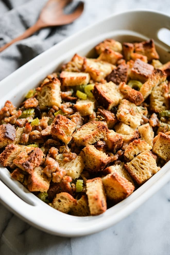 This old-fashioned gluten free stuffing combines traditional flavors of crumbled sausage, fresh herbs, onions, garlic, and celery to create the perfect side dish that will steal the show on your Thanksgiving table! | Fed & Fit