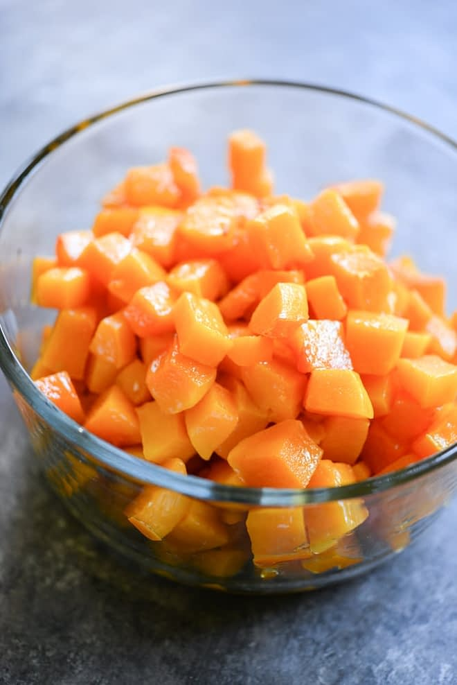 meal prep roasted butternut squash in a glass bowl