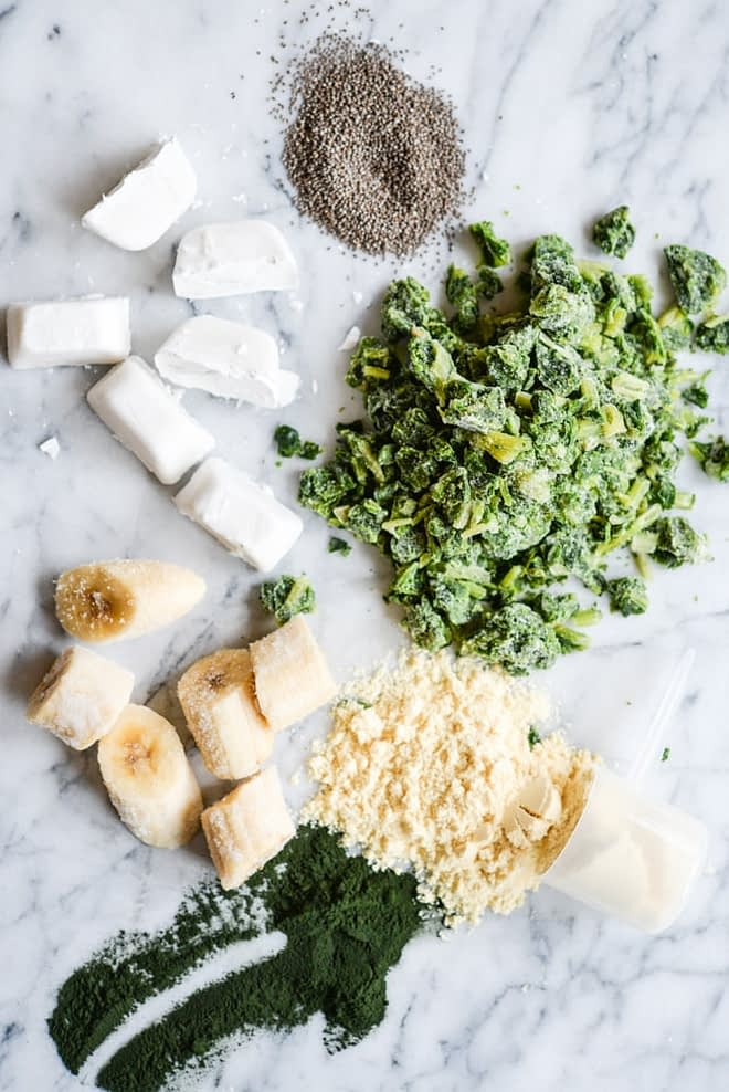 Bananas, spinach, coconut milk ice cubes, and protein powder for Green Protein Smoothie Freezer Packs Fed
