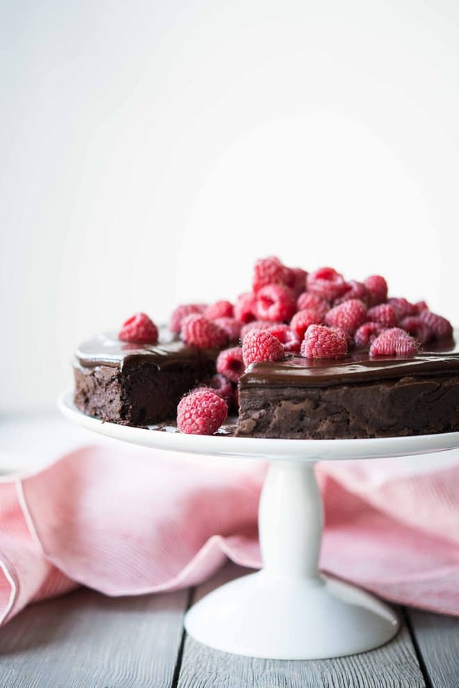 Flourless Chocolate Cake topped with raspberries