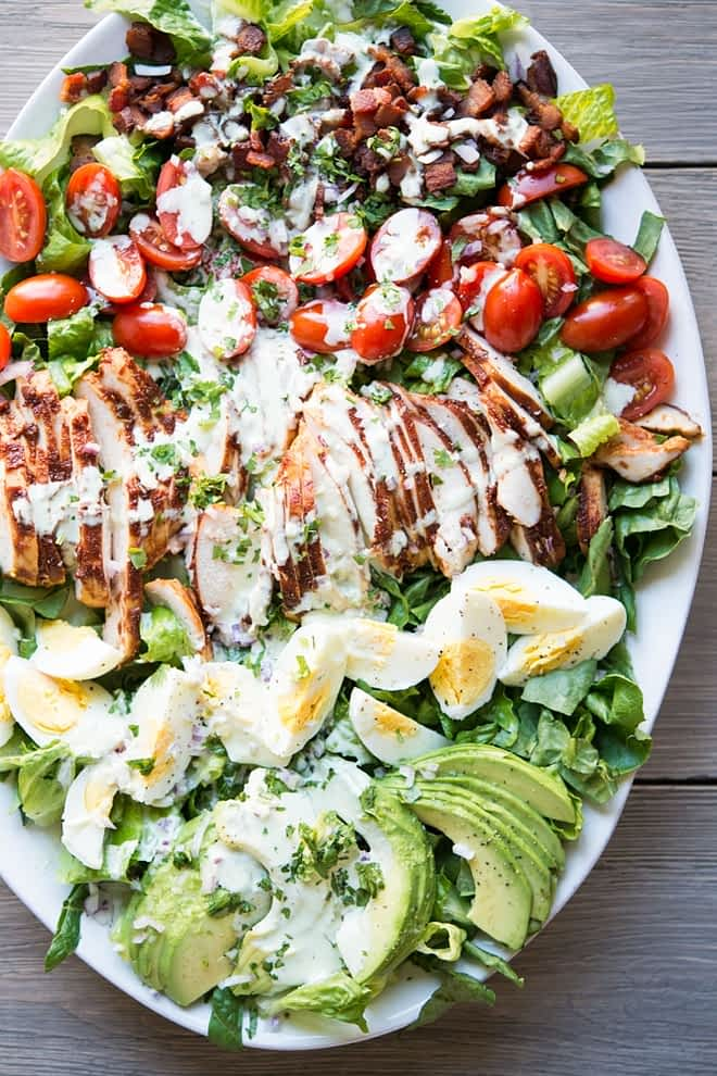 overhead view of a plate of BBQ chicken Cobb salad with jalapeno ranch