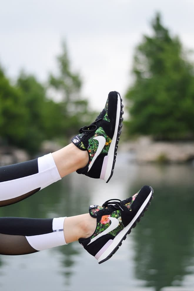 in image of black nike floral sneakers