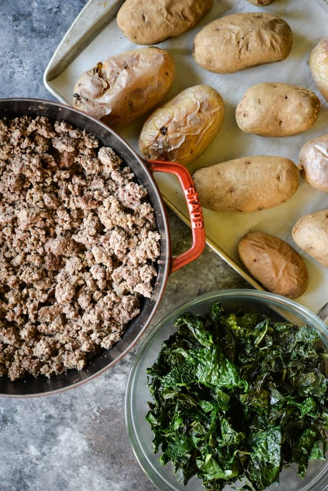 healthy meal prep roundup up ground beef, baked potatoes, kale