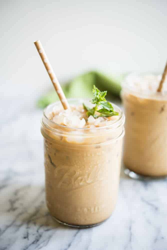 mint iced coffee with mint simple syrup in a mason jar