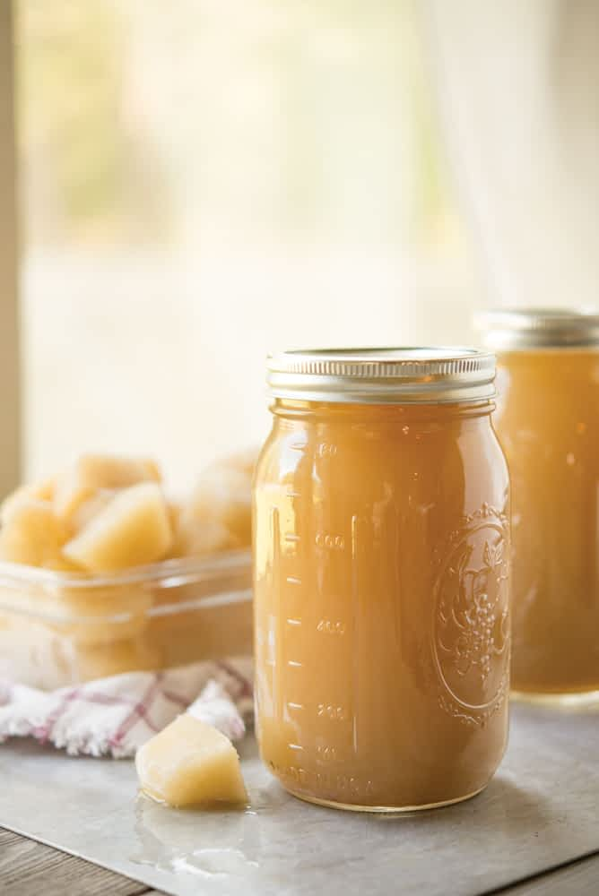 bone broth in a mason jar with bone broth cubes behind it