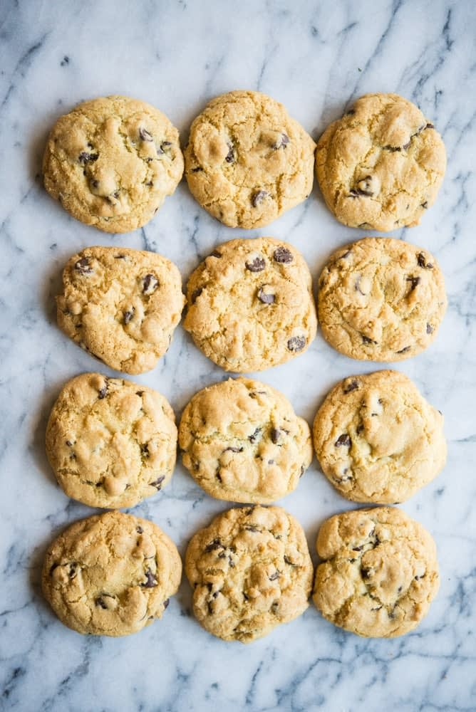 overhead view of chewy gluten free chocolate chip cookies on a marble table