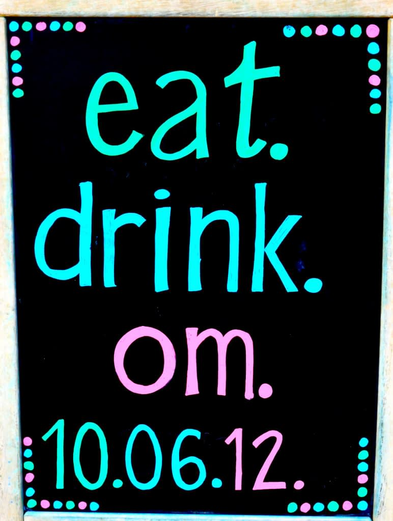 """chalkboard sign that says """"eat.drink.om."""" with the date 10.06.12 on it"""