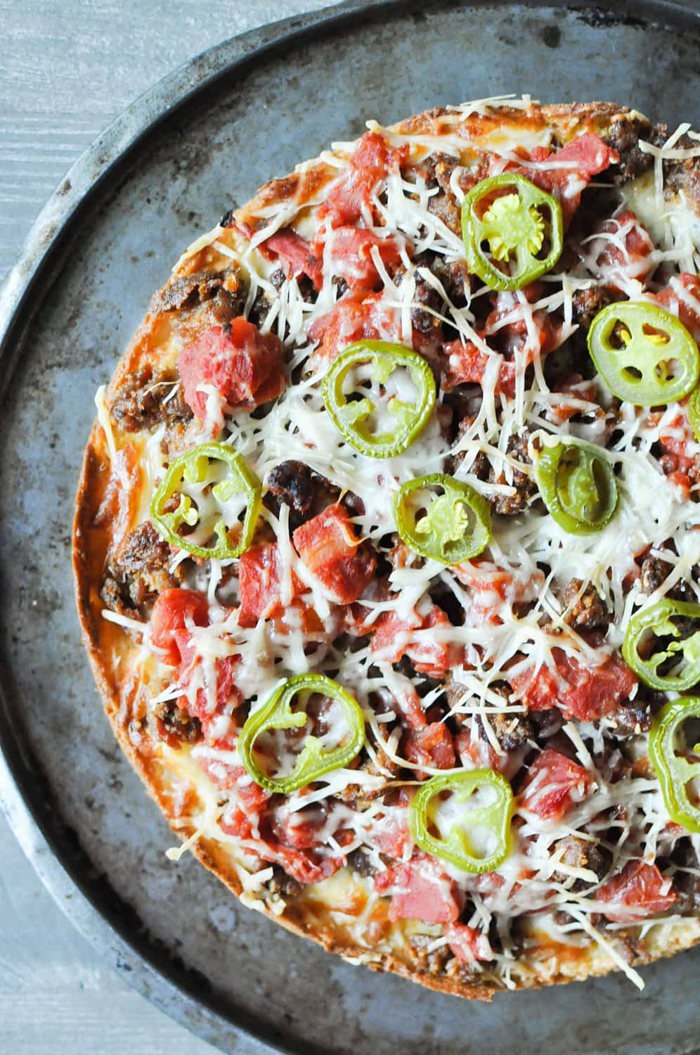 overhead view of a Chicago Deep-Dish Pizza on a round sheet pan
