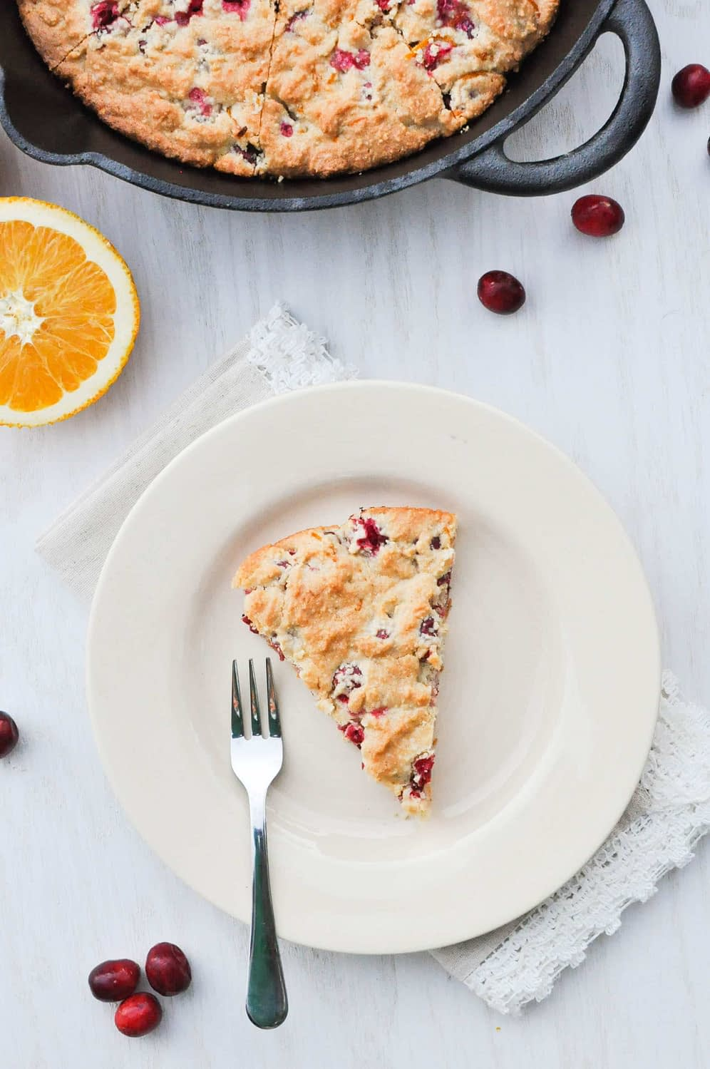 overhead view of cranberry orange scones on a white plate